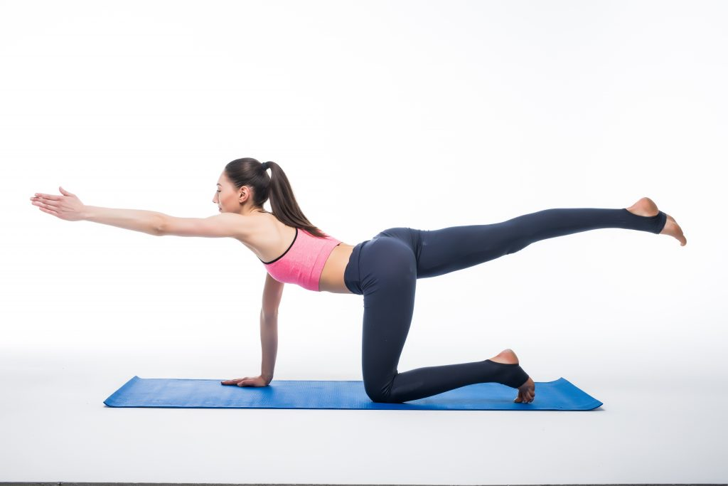 Women doing bird dog exercise for glute activation